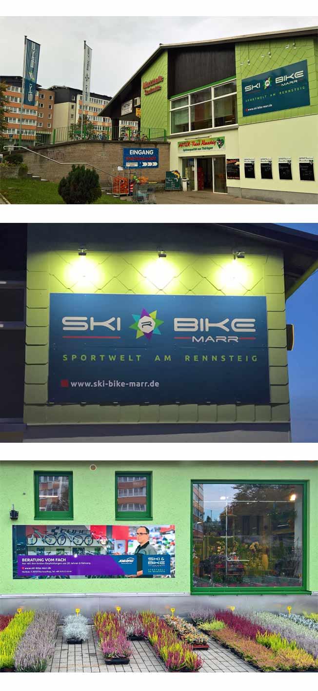 Firmengebäude, Firmenschild und Schild an der Hausfassade von Ski Bike Marr
